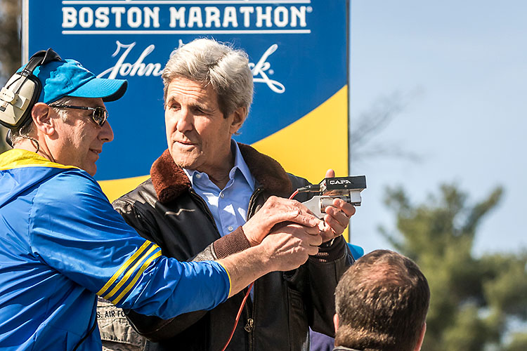 Boston Marathon start, Secretary of State John Kerry, a Massachusetts native, take the starter's pistol prior to sending the elite runners on their way